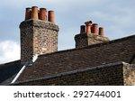 Brick Chimneys On Clayed Old...