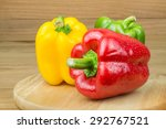 Three Sweet Peppers On A Woode...