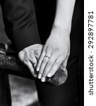 two hands with wedding rings on ... | Shutterstock . vector #292897781