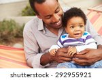 father bonding with young son... | Shutterstock . vector #292955921