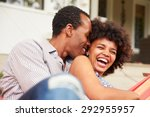 laughing couple cuddling in a... | Shutterstock . vector #292955957