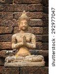 Stone Buddha Statue Seated In...