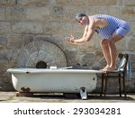 man in retro swimsuit jumps to... | Shutterstock . vector #293034281