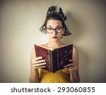 Woman Reading An Old Book