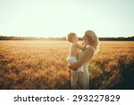 mom and son having fun by the... | Shutterstock . vector #293227829