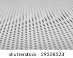 perforated white metal close-up; shallow depth of field - stock photo