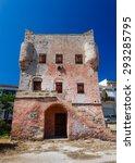 Small photo of Markelos old, red tower in Aegina city, Aegina island in Greece