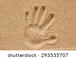 Hand Prints On Sand