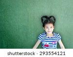 asian school girl kid on green... | Shutterstock . vector #293554121