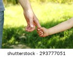 a the parent holding the hand... | Shutterstock . vector #293777051