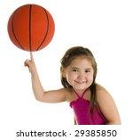 Adorable Pre-Schooler Balancing a Basketball on one Finger. - stock photo