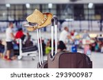 Luggage With Straw Hat At The...