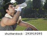 young fit man drinking water... | Shutterstock . vector #293919395