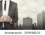 businessman holding light bulb... | Shutterstock . vector #293938121