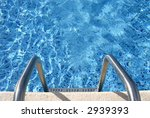 Ladder into the swimming pool - stock photo