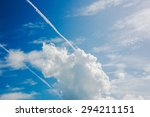 white fluffy clouds in blue sky | Shutterstock . vector #294211151
