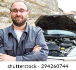 a mechanic crossing his arms... | Shutterstock . vector #294260744