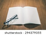 glasses on book with retro... | Shutterstock . vector #294379355