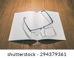 glasses on book with retro... | Shutterstock . vector #294379361