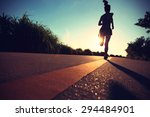 young fitness woman running on...   Shutterstock . vector #294484901