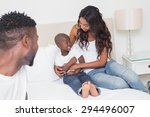 happy family on the bed at home ... | Shutterstock . vector #294496007