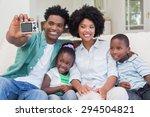 happy family taking a selfie on ... | Shutterstock . vector #294504821