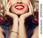 Small photo of Material girl and femme fatale concept. Marilyn Monroe, Madonna style. Close up portrait of rich young woman smiling wearing expensive luxurious golden ring, bracelet. Perfect shiny smile. Studio shot