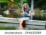 teen girl sitting on a dock... | Shutterstock . vector #294633389