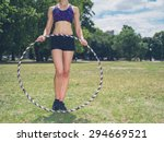 a fit young woman is standing... | Shutterstock . vector #294669521