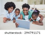 happy family lying on the floor ... | Shutterstock . vector #294791171