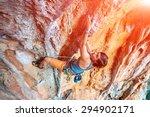 Female Rock Climber Climbs On ...
