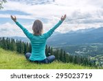 woman meditate at the mountains | Shutterstock . vector #295023719