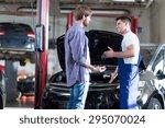 mechanic giving client keys to... | Shutterstock . vector #295070024