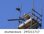 worker prepares a scaffold