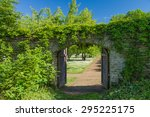 Opened Wooden Gate Covered By...