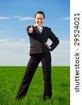 prosperous businesswoman showing thumbs up - stock photo