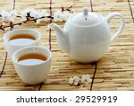 White Cup And Teapot On Bamboo...