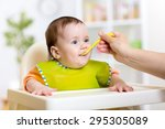 mother feeding baby girl. child ... | Shutterstock . vector #295305089