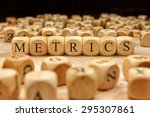 metrics word written on wood... | Shutterstock . vector #295307861