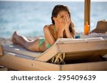 shy woman peeking through... | Shutterstock . vector #295409639