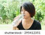 asian young girl drink water on ... | Shutterstock . vector #295412351