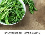 bowl of fresh spinach leaves on ... | Shutterstock . vector #295566047