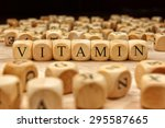 vitamin word written on wood... | Shutterstock . vector #295587665