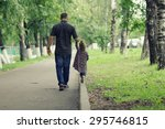 Dad Walks With Her Daughter In...