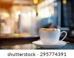 cup of cappuccino with blur... | Shutterstock . vector #295774391