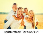 happy young family with two... | Shutterstock . vector #295820114