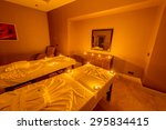 spa room with burning candles | Shutterstock . vector #295834415