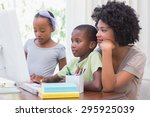 happy family using the computer ... | Shutterstock . vector #295925039