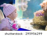 happy baby watching fishes in... | Shutterstock . vector #295956299