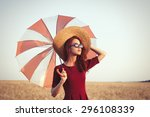 girl in red dress with umbrella ... | Shutterstock . vector #296108339